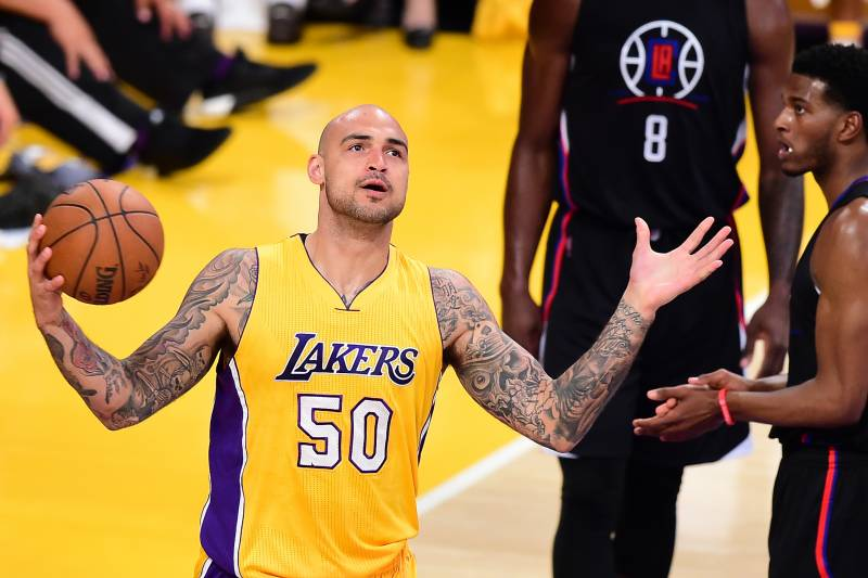 efa058edc Robert Sacre of the Los Angeles Lakers reacts to a missed opportunity  against the Los Angeles
