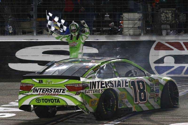Kyle Busch celebrates after winning the NASCAR Sprint Cup Series auto race at Texas Motor Speedway