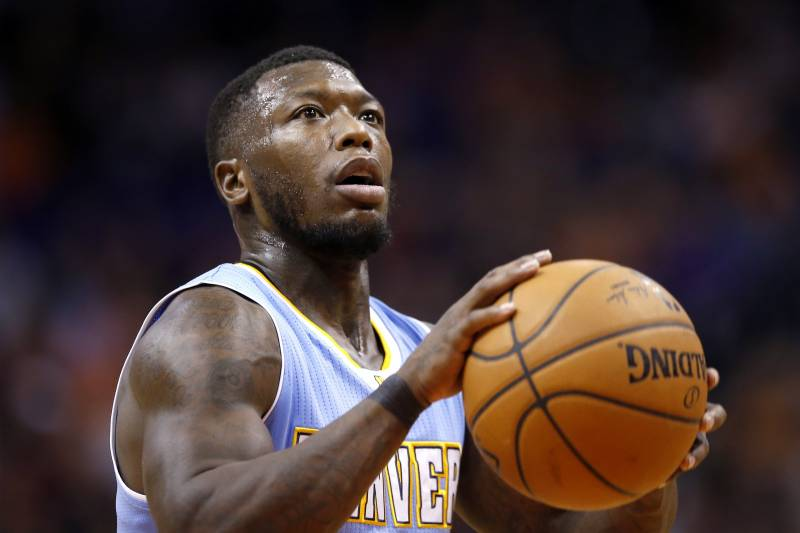 bf0a06cd68d4b Denver Nuggets  Nate Robinson shoots a foul shot during the first half of  an NBA