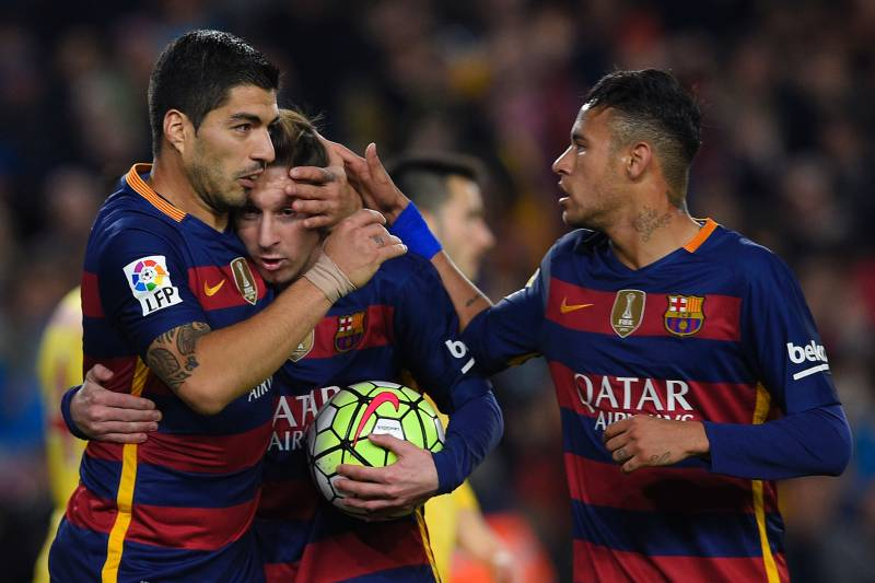 0605ad5ee6c Barcelona s Uruguayan forward Luis Suarez (L) celebrates with Barcelona s  Argentinian forward Lionel Messi (
