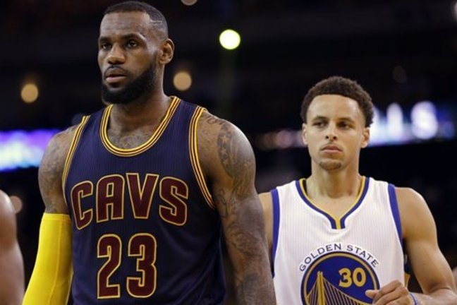 49ee1e328b6d Cleveland Cavaliers forward LeBron James (23) walks in front of Golden  State Warriors guard