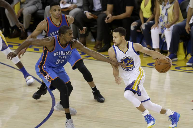 d7c7aa4699a Golden State Warriors guard Stephen Curry (30) dribbles against Oklahoma  City Thunder forward Kevin