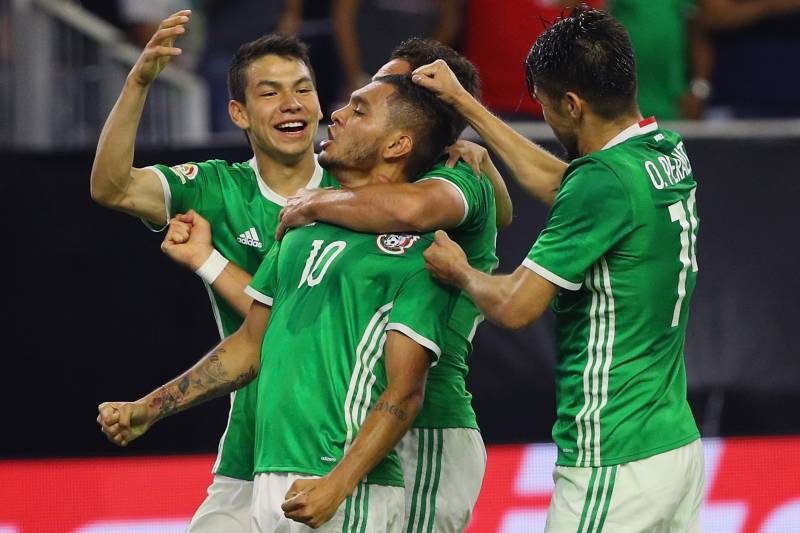 229c7074d Jesus Corona is congratulated after scoring a sensational equaliser for  Mexico.