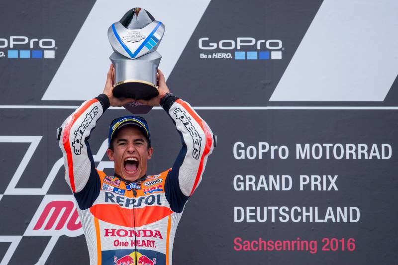 6864713d7497 Honda rider Marc Marquez of Spain celebrates on the podium after winning  the MotoGP race of