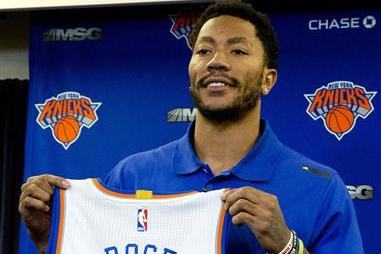 5f7cda9c05a Derrick Rose poses for photographers with his New York Knicks jersey during  a news conference at