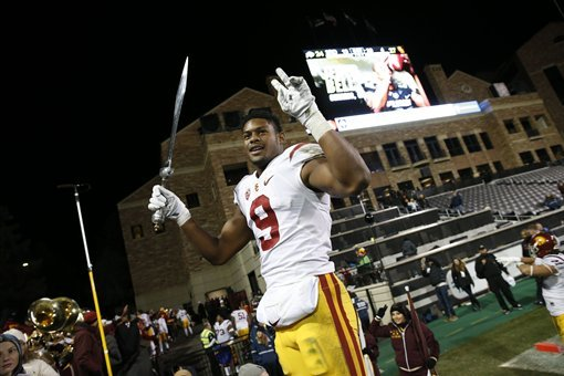 5b578cebba2 Southern California wide receiver JuJu Smith-Schuster (9) leads fans in  sing after