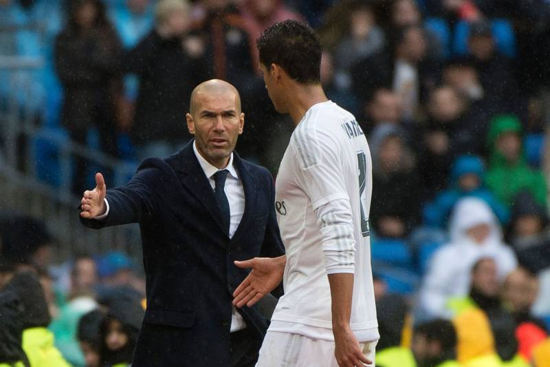 8e52ba10f Real Madrid s French coach Zinedine Zidane (L) congratulates Real Madrid s  French defender Raphael Varane