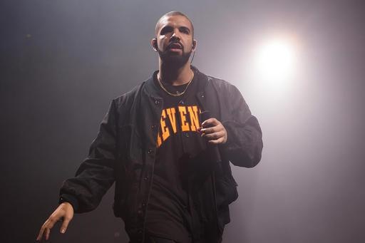 new product 7580a 064ec Drake Wears Devin Booker Jersey During Phoenix Concert ...
