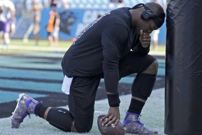 94ef4c4f0372 Cam Newton Pays Tribute to Prince with Customized Cleats Before Game vs.  Vikings