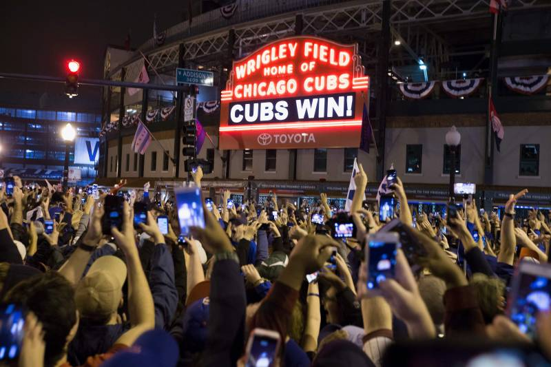 780bf64252b Chicago fans celebrate the Chicago Cubs 8-7 victory over the Cleveland  Indians in Cleveland