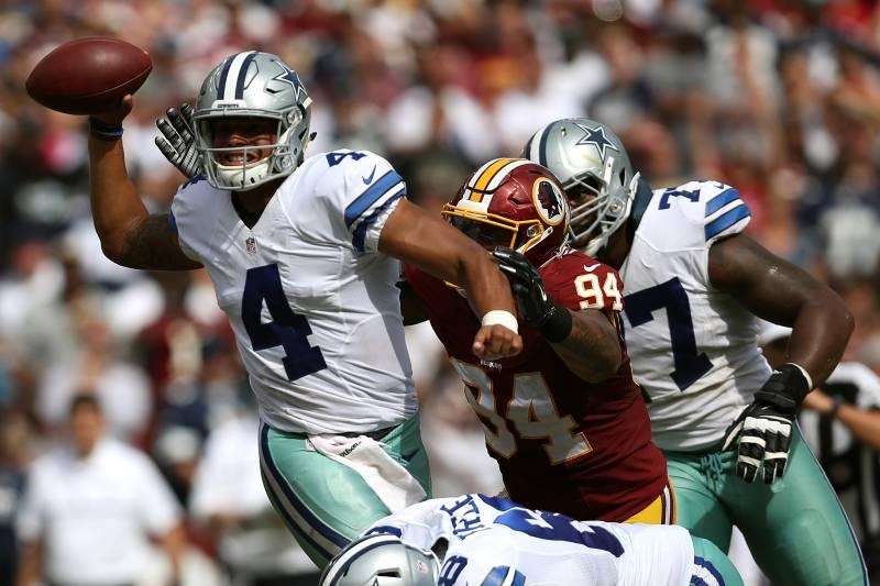 d394429b233 LANDOVER, MD - SEPTEMBER 18: Quarterback Dak Prescott #4 of the Dallas  Cowboys