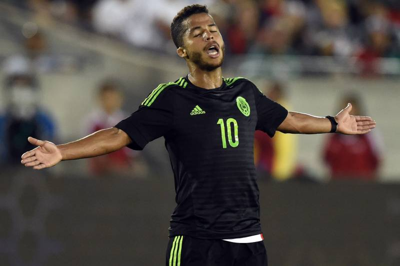 abe0d09d2 Giovani Dos Santos of Mexico reacts to a tackle during a friendly football  match against Ecuador