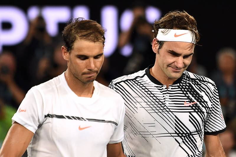 08732717 Switzerland's Roger Federer (R) walks off the court with Spain's Rafael  Nadal after winning