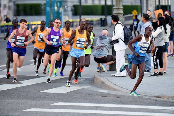 LOS ANGELES, CA - FEBRUARY 14: Weldon Kirui of Kenya leads a pack of runners during the 2016 Skechers Performance Los Angeles Marathon on February 14, 2016 in Los Angeles, California. (Photo by Jonathan Moore/Getty Images)