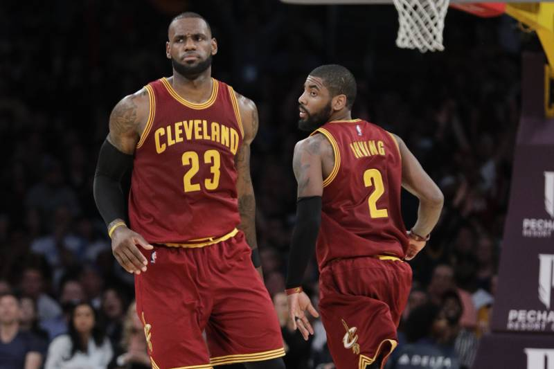 542ac08134253 Cleveland Cavaliers  LeBron James greets Kyrie Irving during the second  half of an NBA basketball