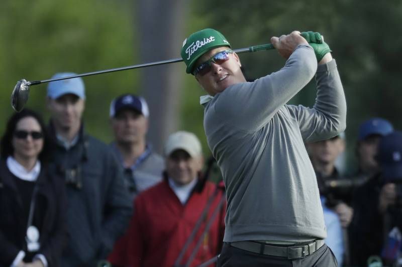 differently 37a40 af3d4 Charley Hoffman hits a drive on the 18th hole during the first round for  the Masters