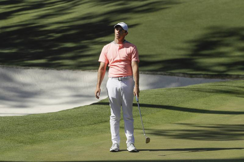 1756f977a Rory McIlroy, of Northern Ireland, reacts to a shot on the 10th hole during