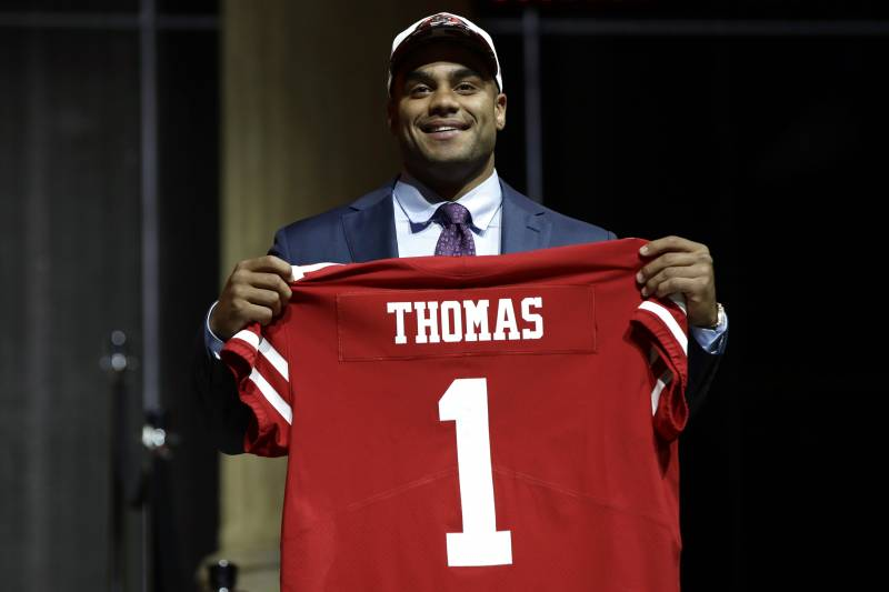 dde79daa7ba Stanford s Solomon Thomas poses after being selected by the San Francisco  49ers during the first round