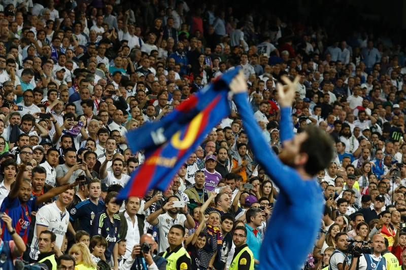 16dc81307ae Barcelona s Argentinian forward Lionel Messi celebrates after scoring  during the Spanish league Clasico football match Real