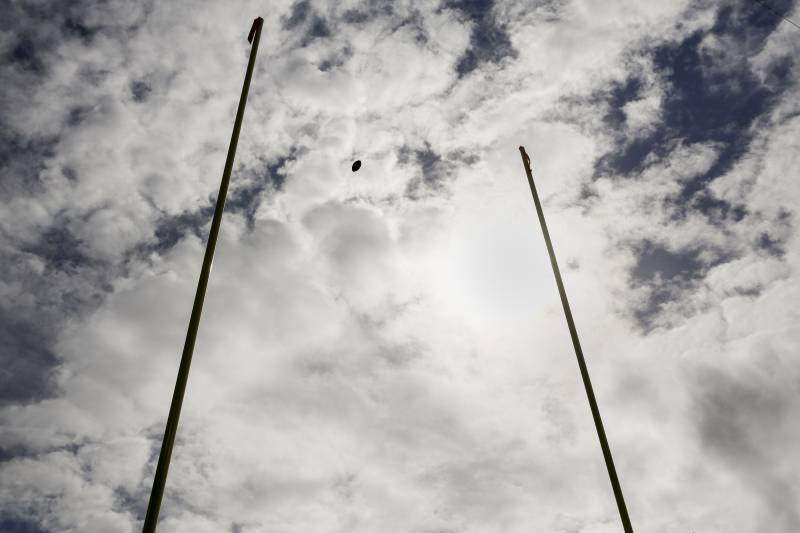 A football flies through the goalposts during warm ups before an NFL football game between the Baltimore Ravens and the Cincinnati Bengals in Baltimore, Sunday, Sept. 27, 2015. (AP Photo/Patrick Semansky)