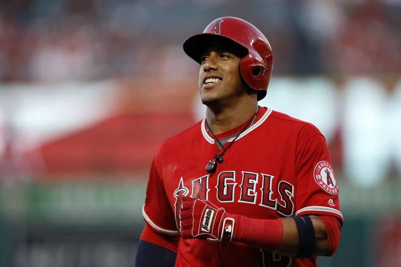 Los Angeles Angels' Yunel Escobar smiles after making an out during the first inning of