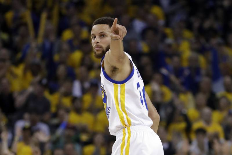 c065669e8c62 Golden State Warriors  Stephen Curry signals after scoring against the San  Antonio Spurs during the