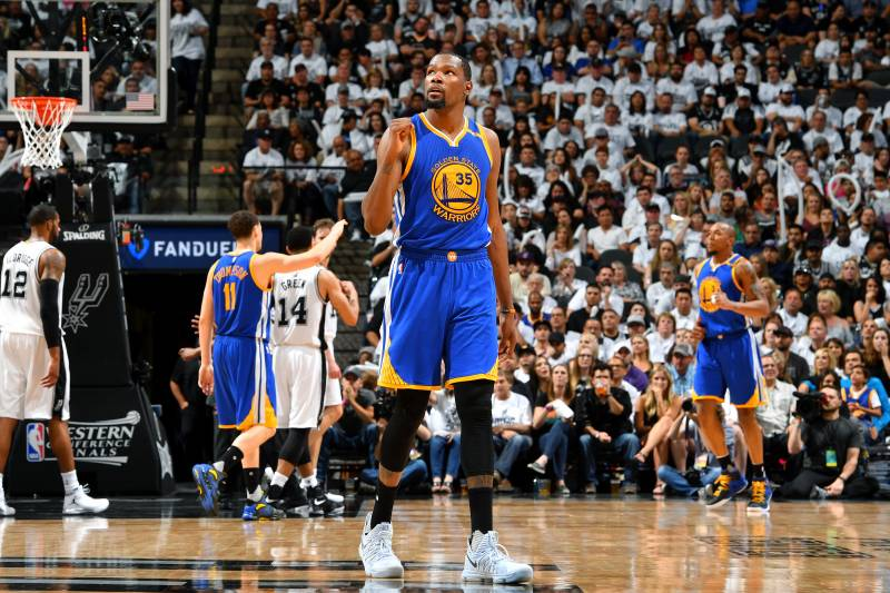 SAN ANTONIO, TX - MAY 20: Kevin Durant #35 of the Golden State Warriors reacts during the game against the San Antonio Spurs during Game Three of the Western Conference Finals of the 2017 NBA Playoffs on May 20, 2017 at the AT&T Center in San Antonio, Texas. NOTE TO USER: User expressly acknowledges and agrees that, by downloading and or using this photograph, user is consenting to the terms and conditions of the Getty Images License Agreement. Mandatory Copyright Notice: Copyright 2017 NBAE (Photos by Jesse D. Garrabrant/NBAE via Getty Images)