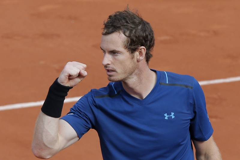 f7836f309fe Britain s Andy Murray celebrates winning his first round match against  Russia s Andrey Kuznetsov in four sets