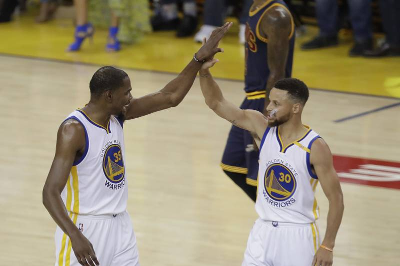 f47c7da903f7 Golden State Warriors forward Kevin Durant (35) and guard Stephen Curry (30)