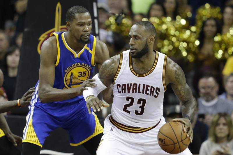 4e4d73e7b11a Golden State Warriors forward Kevin Durant (35) defends Cleveland Cavaliers  forward LeBron James (