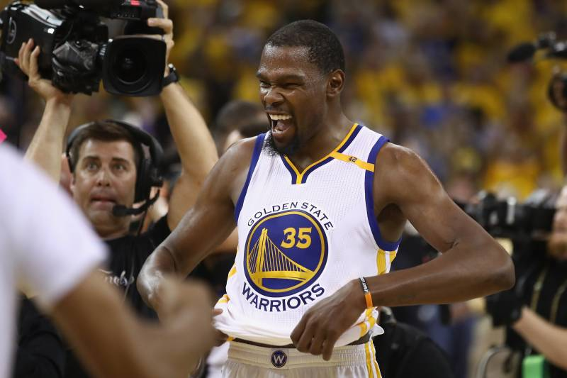 OAKLAND, CA - JUNE 12:  Kevin Durant #35 of the Golden State Warriors celebrates after defeating the Cleveland Cavaliers 129-120 in Game 5 to win the 2017 NBA Finals at ORACLE Arena on June 12, 2017 in Oakland, California. NOTE TO USER: User expressly acknowledges and agrees that, by downloading and or using this photograph, User is consenting to the terms and conditions of the Getty Images License Agreement.  (Photo by Ezra Shaw/Getty Images)
