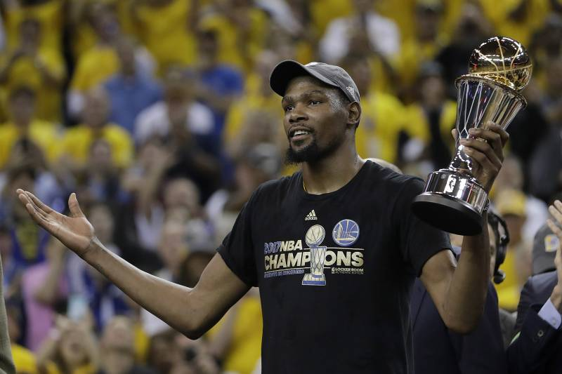 4808ad1eb32 Golden State Warriors forward Kevin Durant gestures as he holds the Bill  Russell NBA Finals Most