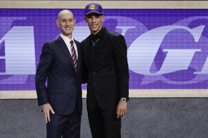 416ba921fe5 Lonzo Ball, right, poses for a photo with NBA Commissioner Adam Silver  after being