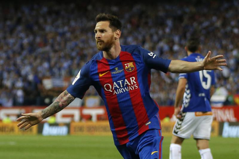 Barcelona's Lionel Messi celebrates after scoring a goal during the Copa del Rey final soccer match between Barcelona and Alaves at the Vicente Calderon stadium in Madrid, Spain, Saturday May 27, 2017. (AP Photo/Daniel Ochoa de Olza)
