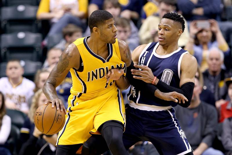 INDIANAPOLIS, IN - MARCH 19:  Paul George #13 of the Indiana Pacers dribbles the ball while defended by Russell Westbrook #0 of the Oklahoma City Thunder at Bankers Life Fieldhouse on March 19, 2016 in Indianapolis, Indiana.   NOTE TO USER: User expressly acknowledges and agrees that, by downloading and or using this photograph, User is consenting to the terms and conditions of the Getty Images License Agreement.  (Photo by Andy Lyons/Getty Images)
