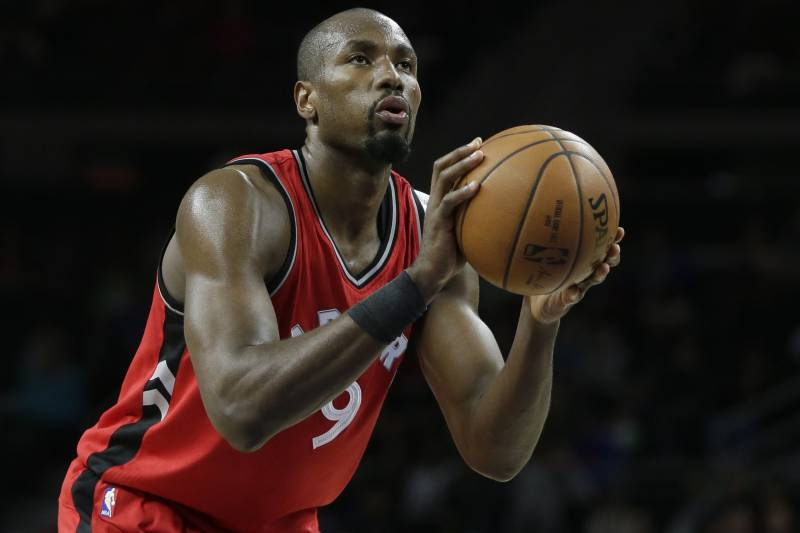 Toronto Raptors forward Serge Ibaka (9) shoots a free throw against the Detroit Pistons during the second half of an NBA basketball game Friday, March 17, 2017, in Auburn Hills, Mich. The Raptors defeated the Pistons 87-75. (AP Photo/Duane Burleson)