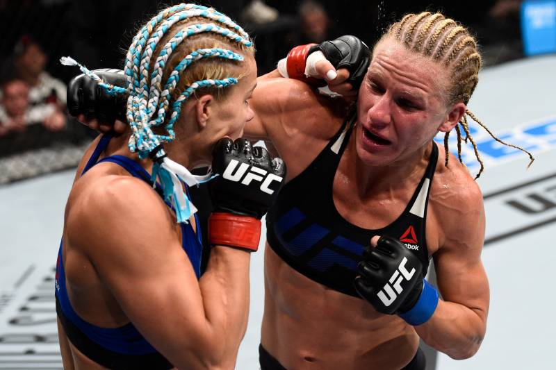 OKLAHOMA CITY, OK - JUNE 25: (L-R) Felice Herrig punches Justine Kish in their women's strawweight bout during the UFC Fight Night event at the Chesapeake Energy Arena on June 25, 2017 in Oklahoma City, Oklahoma. (Photo by Brandon Magnus/Zuffa LLC/Zuffa LLC via Getty Images)