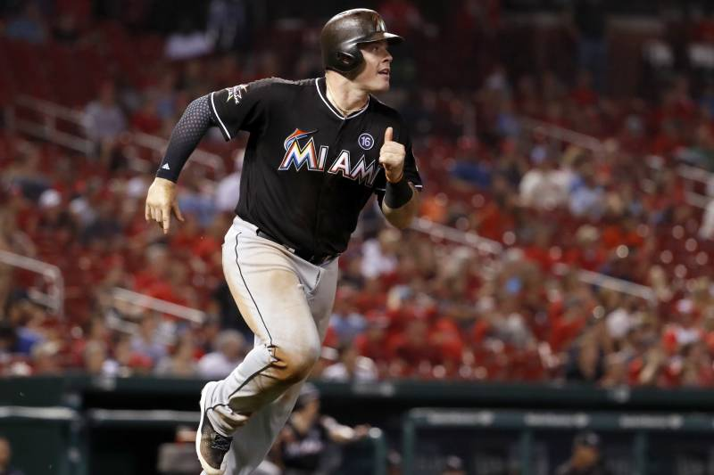 fd25f950 Miami Marlins' Justin Bour watches his solo home run during the ninth inning  of the