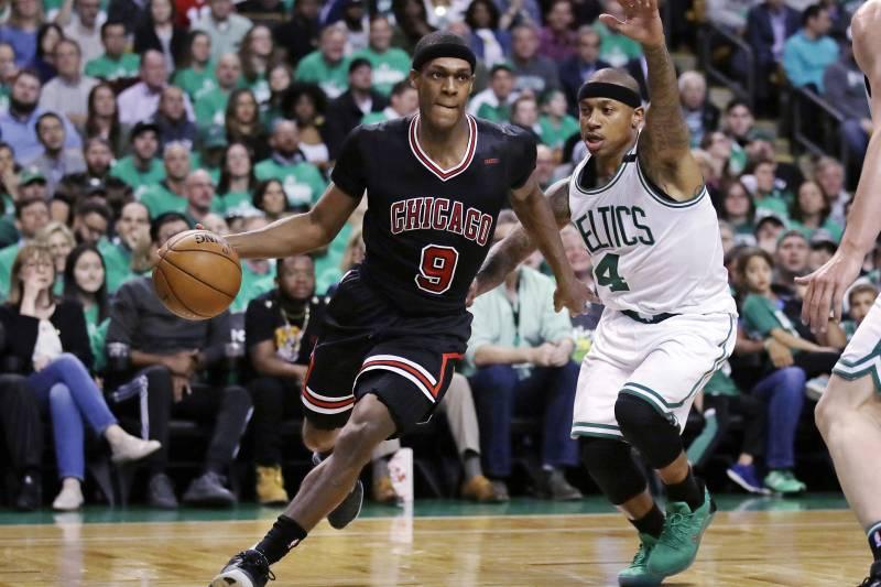 5afded7ecb0 Chicago Bulls guard Rajon Rondo (9) drives towards the basket past Boston  Celtics guard