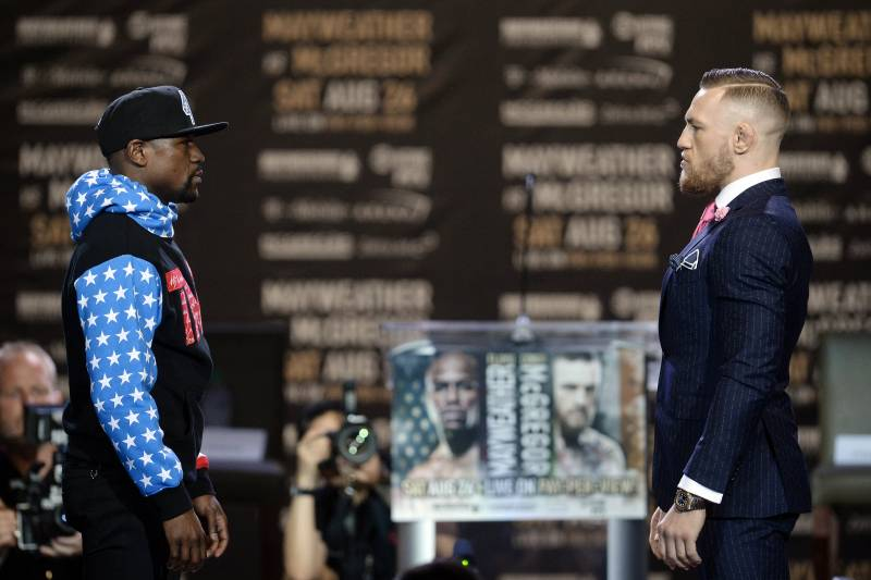 July 11, 2017; Los Angeles, CA, USA; Floyd Mayweather and Conor McGregor stare down one another during a world tour press conference to promote the upcoming Mayweather vs McGregor boxing fight at Staples Center. Mandatory Credit: Gary A. Vasquez-USA TODAY Sports