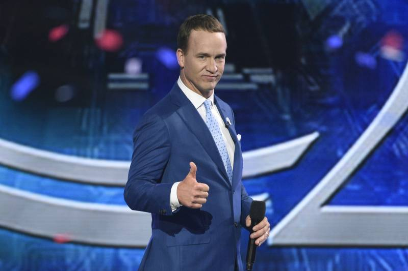 e48c8e388626 Host Peyton Manning appears on stage at the conclusion of the ESPYS at the  Microsoft Theater
