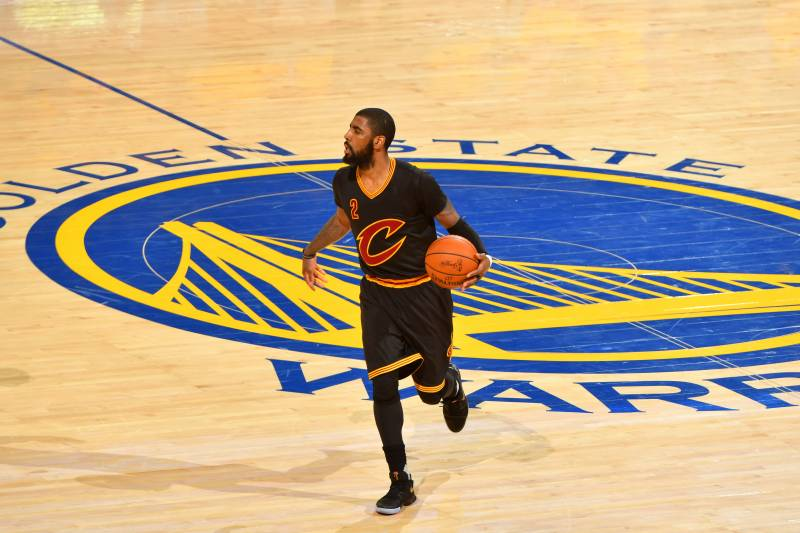 OAKLAND, CA - JUNE 12: Kyrie Irving #2 of the Cleveland Cavaliers dribbles the ball up court against the Golden State Warriors in Game Five of the 2017 NBA Finals on June 12, 2017 at Oracle Arena in Oakland, California. NOTE TO USER: User expressly acknowledges and agrees that, by downloading and or using this photograph, user is consenting to the terms and conditions of Getty Images License Agreement. Mandatory Copyright Notice: Copyright 2017 NBAE (Photo by Jesse D. Garrabrant/NBAE via Getty Images)