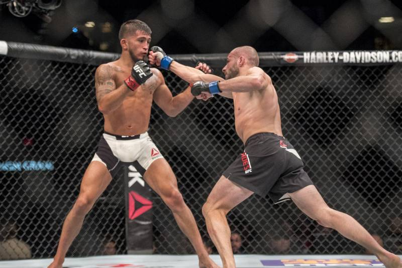 Apr 23, 2016; Las Vegas, NV, USA; Sergio Pettis (red gloves) competes against Chris Kelades (blue gloves) during UFC 197 at MGM Grand Garden Arena. Mandatory Credit: Joshua Dahl-USA TODAY Sports
