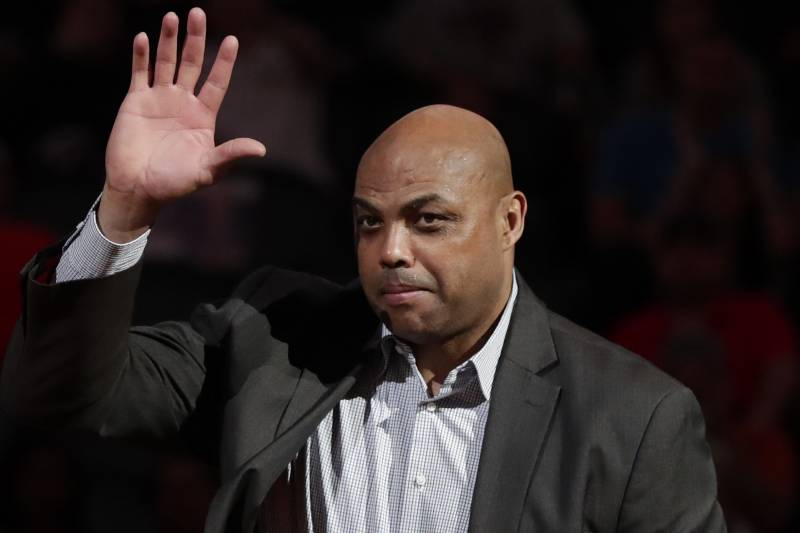 Former Phoenix Suns' Charles Barkley waves at the Phoenix Suns ring of honor induction ceremony