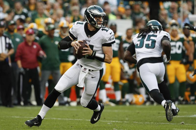 883bf3e5288 Philadelphia Eagles' Carson Wentz drops back during the first half of a preseason  NFL football