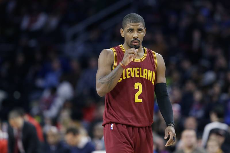 7a79ebef827a Cleveland Cavaliers guard Kyrie Irving walks up court during the first half  of an NBA basketball