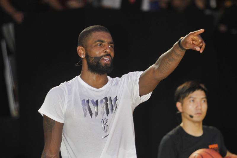 57a090f823b NBA Cleveland Cavaliers guard Kyrie Irving gives instructions while he  holds a short basketball clinic with