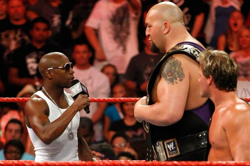 LAS VEGAS - AUGUST 24: (L-R) Boxer Floyd Mayweather Jr. appears in the ring with wrestlers Big Show and Chris Jericho during the WWE Monday Night Raw show at the Thomas & Mack Center August 24, 2009 in Las Vegas, Nevada. Mayweather was a special guest host during the broadcast. (Photo by Ethan Miller/Getty Images)