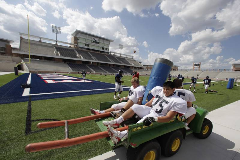 Football players take the field for practice at the new  $60 million new football stadium at Allen High School Tuesday, Aug. 28, 2012 in Allen, Texas.  Allen High School northeast of Dallas christens the stadium Friday night with a matchup against defending state champion Southlake Carroll. While other school districts are struggling to retain teachers and keep classroom sizes down, Allen voters approved a $119 million bond issue that pays for the stadium and other district facilities. (AP Photo/LM Otero)