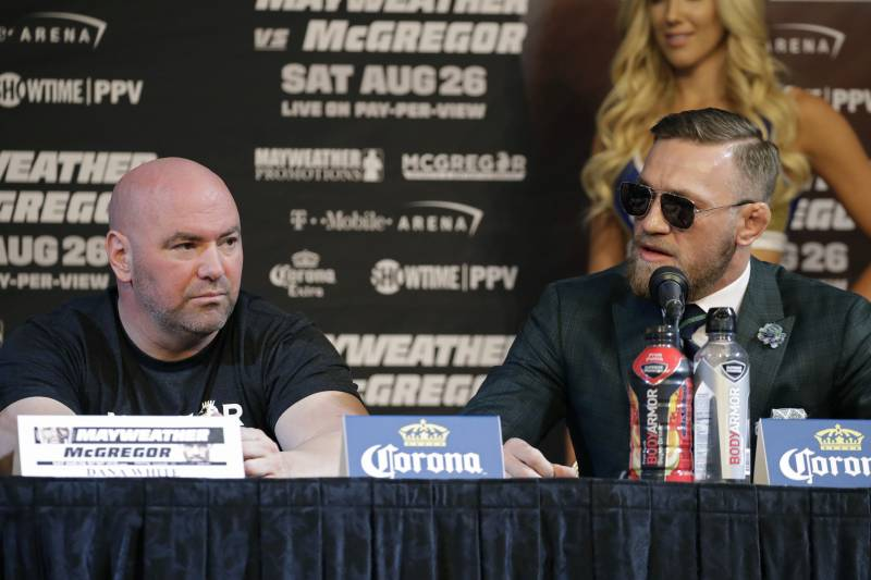 Conor McGregor, right, speaks during news conference Wednesday, Aug. 23, 2017, in Las Vegas. McGregor is scheduled to fight Floyd Mayweather Jr. in a boxing match Saturday in Las Vegas. Dana White is on the left. (AP Photo/John Locher)